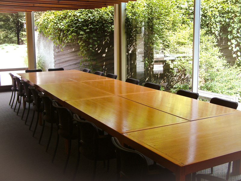 photo of boardroom table and outdoor courtyard